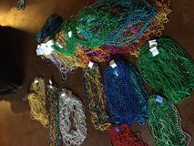 Mardi Gras beads in pack of 12 count in Leesville, Louisiana