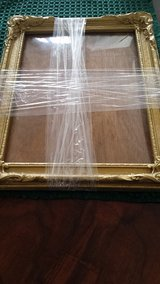 Antique picture frame with bowed glass in Beaufort, South Carolina