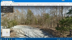 1/2 acre vacant wooded lot in Bella Vista, Arkansas in Naperville, Illinois