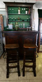 solid oak bar with 2 stools and shelves in the back in Spangdahlem, Germany