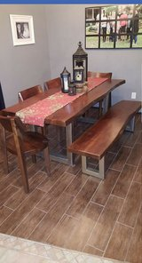 Dining room table with 4 chairs and bench in Huntsville, Texas