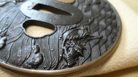 Iron Tsuba depicting a Battle scene of a Samurai chasing the Enemy across a River in Okinawa, Japan