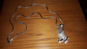 Praying hands necklace in Fort Knox, Kentucky