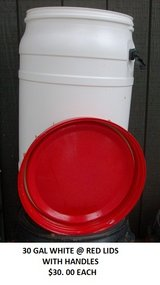 RED AND WHITE 30 GAL PLASTIC BARREL, SCREW ON LIDS WITH HANDLES in Tacoma, Washington