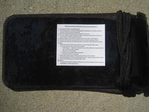 Waterproof pouch and neck cord in Fort Rucker, Alabama