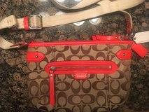 Orange and brown coach bag in Fort Campbell, Kentucky
