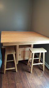 Table with 4 stools in Camp Lejeune, North Carolina