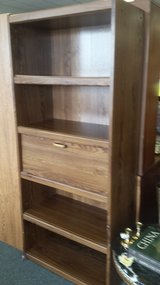 Tall bookcase with desk in Oswego, Illinois