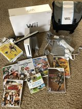 Nintendo wii with games,2 controllers white/black, one nunchuck in Lakenheath, UK