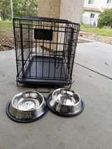 small dog kennel with bowls in Camp Pendleton, California