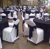 White chair covers with black in Elgin, Illinois