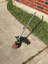 Weed eater attachment in Kingwood, Texas