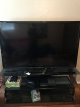 """Sharp 70"""" tv and stand in The Woodlands, Texas"""