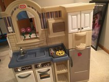 Little Tykes double sided play kitchen with cart and accessories in Naperville, Illinois