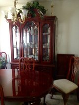 China hutch and matching table with 4 chairs and 2 arm chairs in cherrywood and matching buffet. in Clarksville, Tennessee