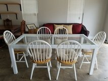 Kitchen table with 6 solid wood chairs. Comes with removable cushions in Byron, Georgia