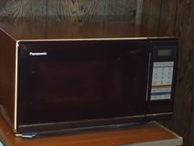 older microwave w/turntable in Glendale Heights, Illinois