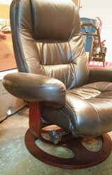 Leather chair with matching leather footstool in Algonquin, Illinois
