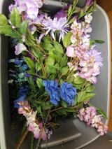 Tote of purple & blue silk flowers in Conroe, Texas