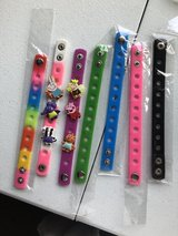 Peppa Pig charm bracelet with several colored bands in Plainfield, Illinois