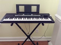 Yamaha keyboard with stand in Perry, Georgia