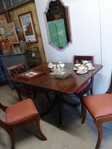 signed Brandt dining table and harp back chairs in Camp Lejeune, North Carolina