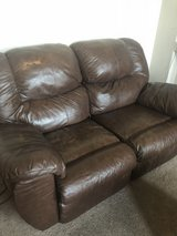 Reclining leather love seat in Fort Bliss, Texas