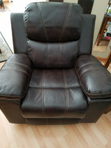 Brown Leather  Swivel Rocker Recliner in The Woodlands, Texas