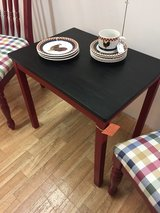Table with black top and red legs in Fort Campbell, Kentucky