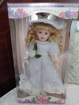 Porcelain doll still in box. in The Woodlands, Texas