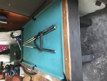 Pool table with two sticks and a setting traingle text me 8324287461 in Kingwood, Texas
