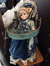 French Doll in high chair in Ramstein, Germany