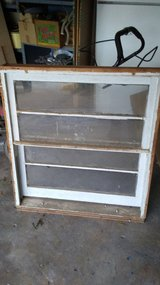 small vintage window with frame intact in Cleveland, Texas