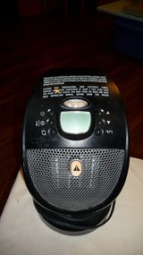 Heater.... 14 inches tall x 8 inches wide. Program the heat level or fan you want in Okinawa, Japan