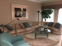 Gorgeous modern sectional couch with cocktail table, rug and lamp in Glendale Heights, Illinois
