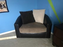 Leather swivel chair with micro fiber cushion and pillows in Hemet, California