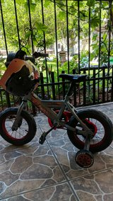 boys bike and helmet like new in Kingwood, Texas