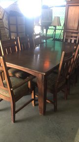 Ashley dinette set eight chairs with I leaf in 29 Palms, California