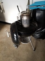 24 inch Weber kettle Grill comes with charcoal starter in Oswego, Illinois