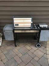 Weber Genesis GOLD grill 3 burner side burner and lots of table shelves in Oswego, Illinois