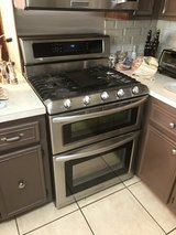 Gas stainless steel, 5 burner range, double oven and microwave combo in Plainfield, Illinois
