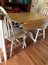 Drop leaf round pedestal table w/2 chairs in Hopkinsville, Kentucky