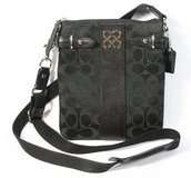 Coach black signature crossbody swingpack bag in Joliet, Illinois