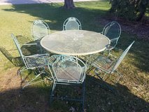 Round wrought iron patio table and 6 chairs in Oswego, Illinois