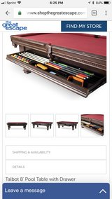 Pool table with slide out storage drawer in Waukegan, Illinois