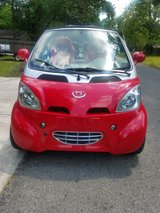 Red Electric Car in The Woodlands, Texas