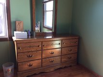 9 drawer oak dresser with mirror and matching night stand, excellent condition. in Glendale Heights, Illinois