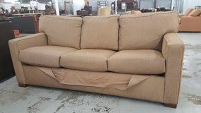 Tan couch in Camp Lejeune, North Carolina