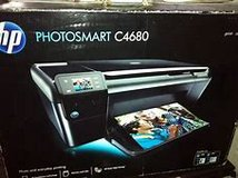 HP PHOTOSMART C4680 PRINT SCAN COPY new in unopened box extra black cartridge in Orland Park, Illinois