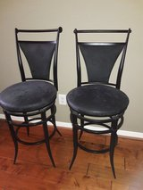 Black bar stools in need of some TLC in Houston, Texas